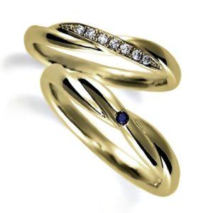 イエローゴールドのペア結婚指輪、クロスデザイン、女性用ダイヤモンド入り