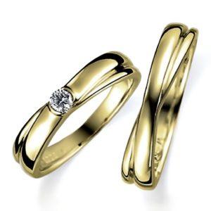 イエローゴールドのペア結婚指輪、抱き合わせアームデザイン、女性用はダイヤモンド入り