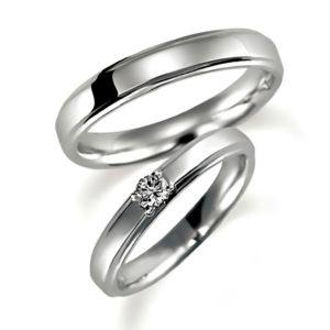 プラチナのペア結婚指輪、女性用にはダイヤモンド1個入り、甲丸リング