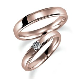 ピンクゴールドのペア結婚指輪、女性用にはダイヤモンド1個入り、甲丸リング