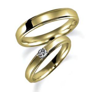 イエローゴールドのペア結婚指輪、女性用にはダイヤモンド1個入り、甲丸リング